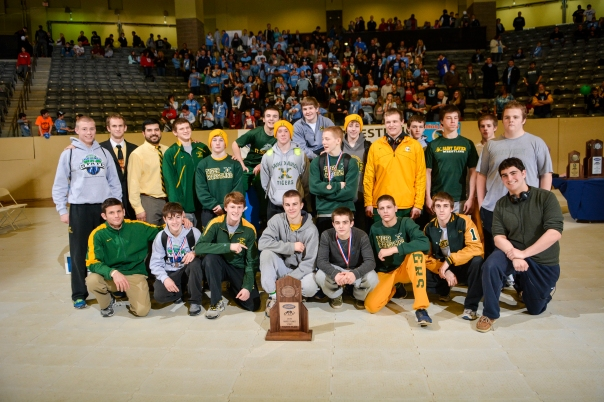 The Tiger Wrestling team poses with their 4th place trophy after an exciting day at Alltech Arena | Photo by Tim Webb