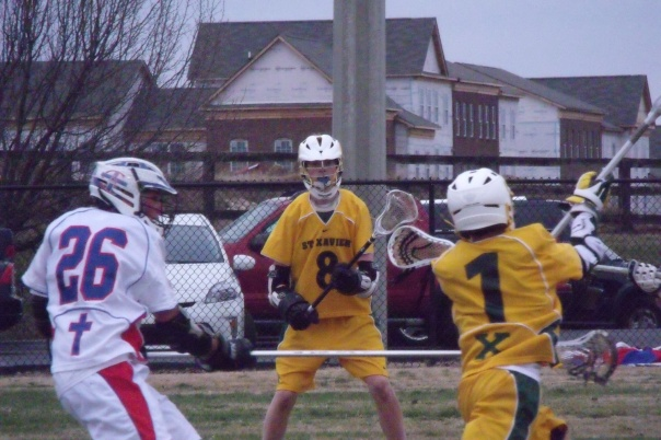 John Mueller (8) looks on as Nicolas Malubdey (1) makes a move during the JV game against CAL   Photo by Chris Raymond