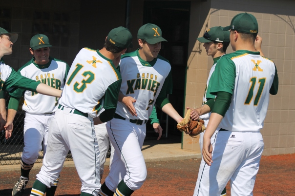 Cam Revelette heads to the mound after being introduced | Photo by Jacob Hayslip