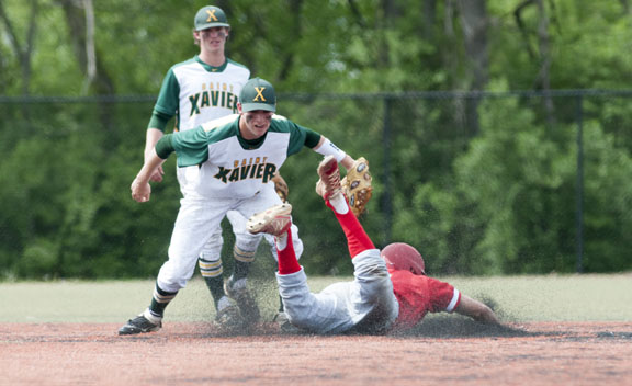 Josh Finerty (17) tagged out Manual's Jake Rist (9) at second. | Photo by The Voice Tribune