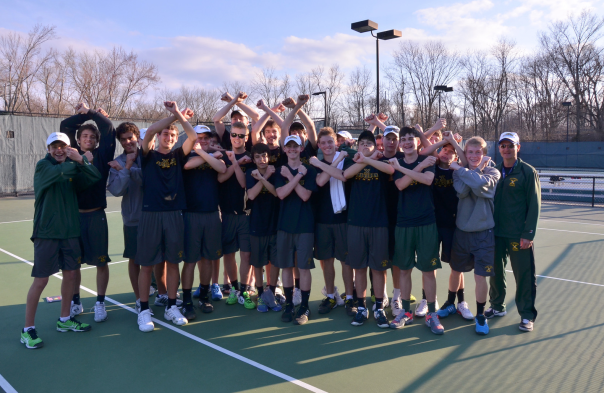 The Tiger Tennis team throws up their X's at the DecoTurf National Championships | Photo by Louisville Sharp Photography