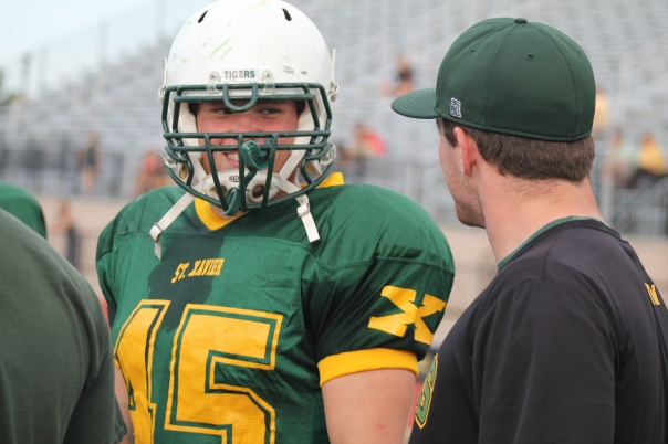Andrew McCormick talks to fellow St. Raphael Giant Dylan McFarland during the Tiger Football Spring Game | Photo by Jacob Hayslip