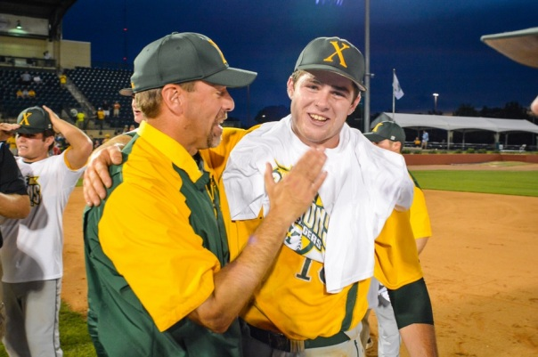 Coach Porta and Andrew McCormick celebrate their state championship victory. | Photo by Tim Webb