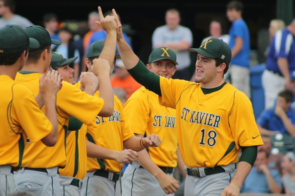 McCormick high-fives a teammate before the start of the baseball state championship game. | Photo by Jacob Hayslip