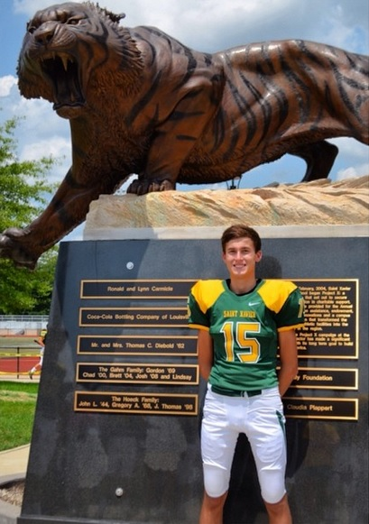 Ben Logsdon poses with the Tiger Statue!