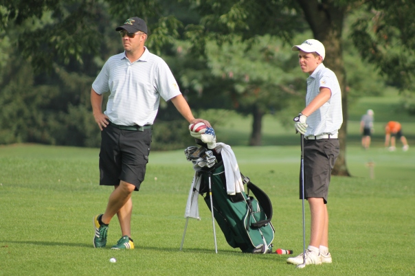 Coach Utley instructs Matt before his approach. | Photo by Jacob Hayslip