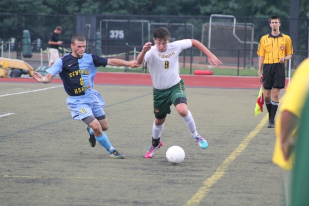 Senior midfielder Zach Vititoe tracks down a ball. | Photo by Jacob Hayslip
