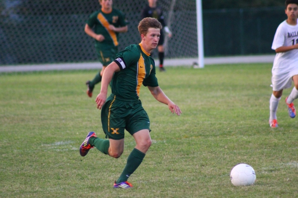 Senior captain Andrew Schaefer chases a ball Wednesday night against Ballard. | Photo by Jacob Hayslip
