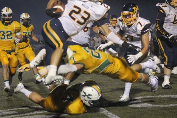 Davey Sermersheim lays out to take down a Moeller running back. | Photo by Jacob Hayslip