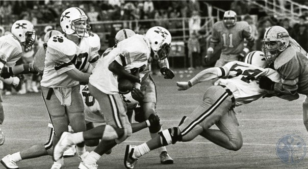 Jeff Houk hands off to a  teammate during the 1986 4-A Ky State Championship game at Old Cardinal Stadium. | Photo by Terry Duennes