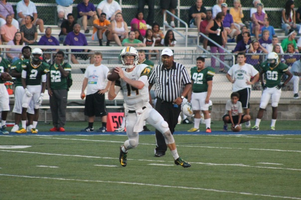 Noah Houk rolls out against Bryan Station in the Tigers' week 2 win over the Defenders | Photo by Jacob Hayslip