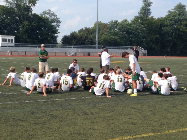 Coach Porta and Coach Durbin talk to the team at halftime Saturday afternoon. | Photo by Chris Raymond