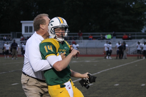 Coach Wolford embraces Noah Houk after a Tiger touchdown | Photo by Jacob Hayslip