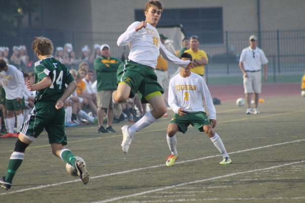 Senior striker Dean Mock makes a leaping attempt to intercept a Trinity pass Wednesday night. | Photo by Jacob Hayslip
