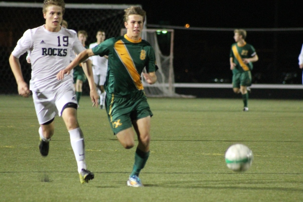 Senior striker Klayton Grimes chases a ball Thursday night against Trinity. | Photo by Jacob Hayslip