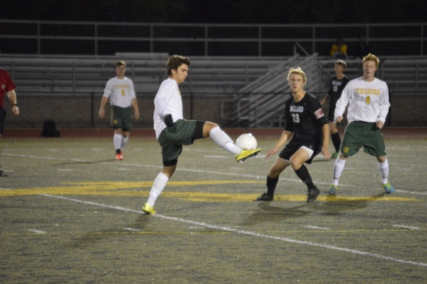 Junior midfielder Colin Kremer controls a ball Tuesday night against Ballard. | Photo by Gus Young