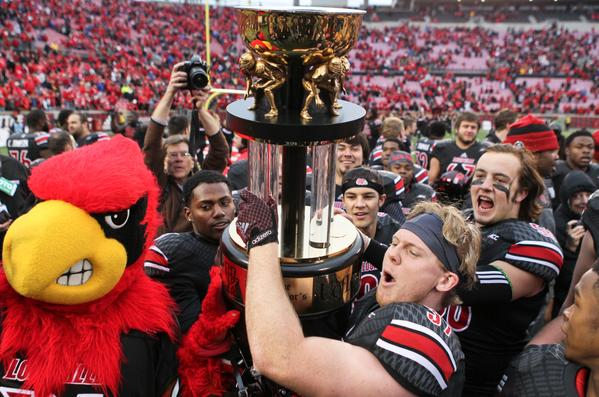 Luke Brohm and the Cardinal Bird hoist the Governor's Cup trophy! Also pictured is our other two Former Tigers Spencer Foy and way in the background, No. 67 Andrew Polston. | Photo by Matt Stone