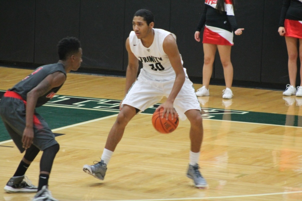 Senior Shamrock Michael Stafford anchors Trinity's guards. | Photo by Jacob Hayslip