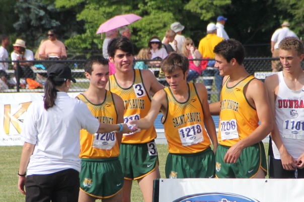 The 4x800 Relay Team broke a school and state record to start the day out for Tiger Track & Field | Photo by Jana Bollinger
