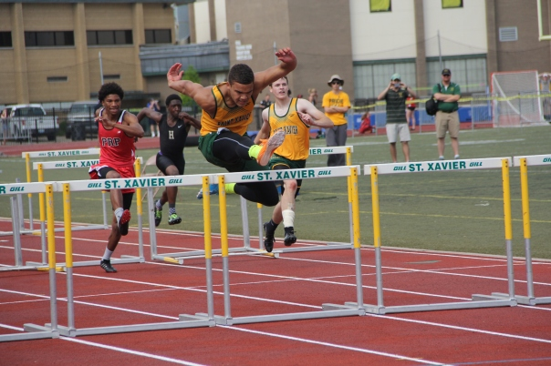 Jaylon Hibbs jumps over a hurdle on his way to a 1st place finish in the 110 meter hurdles | Photo by Jana Bollinger