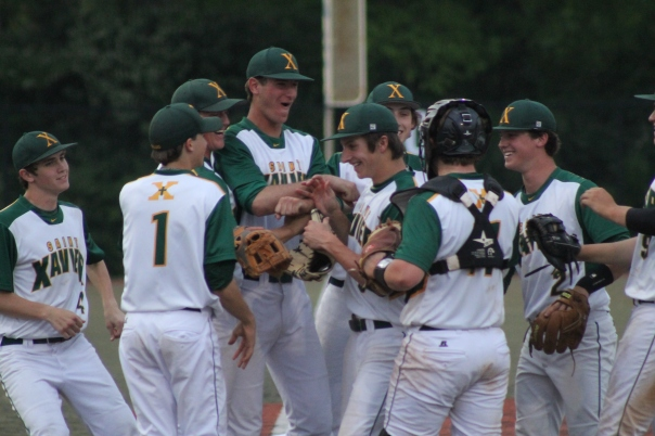 Adam Elliott embraced by his teammates after his dominating performance. | Photo by Jacob Hayslip